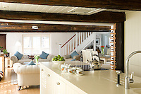 A spacious living and dining area opens out from the kitchen