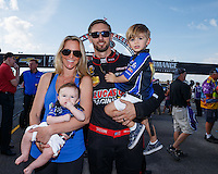 Sep 5, 2016; Clermont, IN, USA; NHRA top fuel driver Morgan Lucas with wife Katie Lucas and sons Hunter Lucas and Austin Lucas during the US Nationals at Lucas Oil Raceway. Mandatory Credit: Mark J. Rebilas-USA TODAY Sports