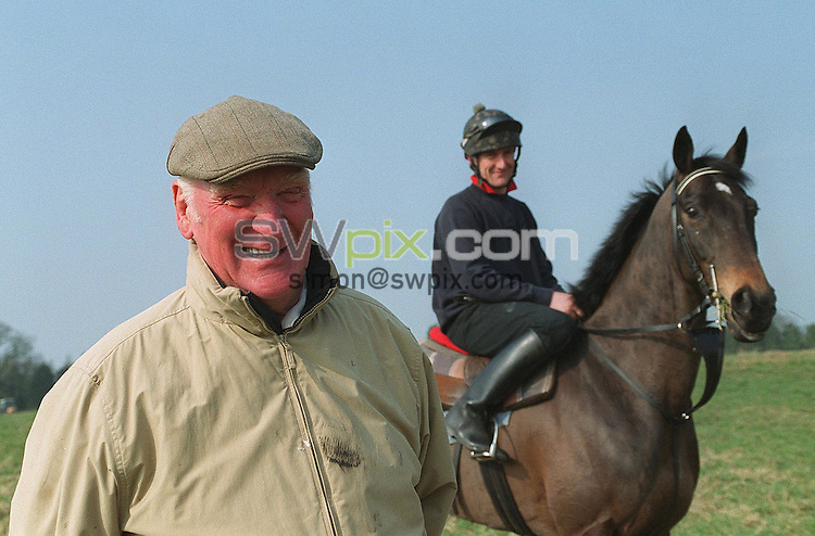 Pix: BEN DUFFY/SWpix.com...Horse Racing..Cheshire based horse trainer, Ginger McCain...28/03/03..COPYRIGHT PICTURE>>SIMON WILKINSON>>01943 436649>>..Cheshire based race horse trainer, Ginger McCain with his Grand National hope, Amberleigh House, here ridden by Ginger's son Donald