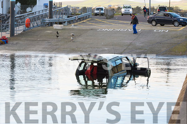 Driver fell off his car while watching the launch of a boat from the slipway at the Dingle Marina, and took a dip into the water.