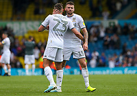 Leeds United's Stuart Dallas embraces Kalvin Phillips after the final whistle<br /> <br /> Photographer Alex Dodd/CameraSport<br /> <br /> The EFL Sky Bet Championship - Leeds United v Nottingham Forest - Saturday 10th August 2019 - Elland Road - Leeds<br /> <br /> World Copyright © 2019 CameraSport. All rights reserved. 43 Linden Ave. Countesthorpe. Leicester. England. LE8 5PG - Tel: +44 (0) 116 277 4147 - admin@camerasport.com - www.camerasport.com