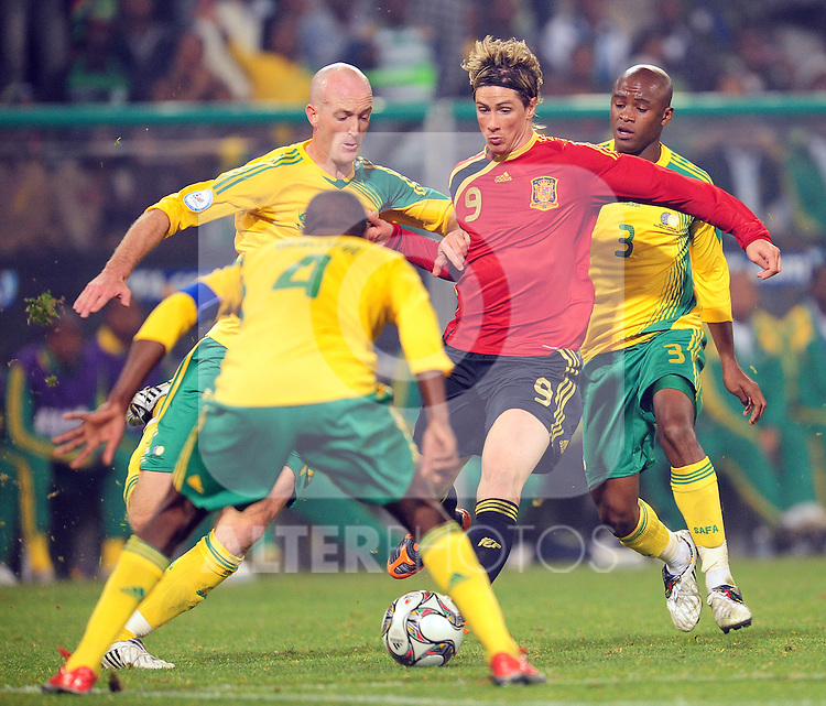 Torres surrounded by Bafana players  during the soccer match of the 2009 Confederations Cup between Spain and South Africa played at the Freestate Stadium,Bloemfontein,South Africa on 20 June 2009.  Photo: Gerhard Steenkamp/Superimage Media.