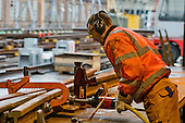 A worker in the Points and Crossings Shed of London Underground's  Lillie Road Depot assembles a section of new crossing.  The depot produces replacement track for the tube network and offers a same day service for 'urgencies and emergencies'.  The depot is now run by London Underground following the collapse of PPP contractor Metronet in 2007.