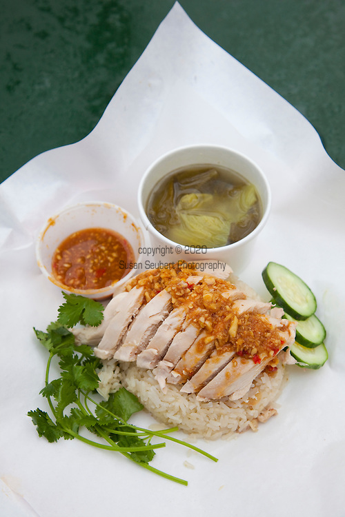 Nong's Khao Man Gai, a Thai food cart featuring the dish, Khao Man Gai, styled authentically after the street vendors of Bangkok.  Chef/Owner Nong Poonsukwattana oversees the one dish food cart in downtown Portland, Oregon. Pictured here is the only thing they serve, chicken with the sauce, rice and soup.