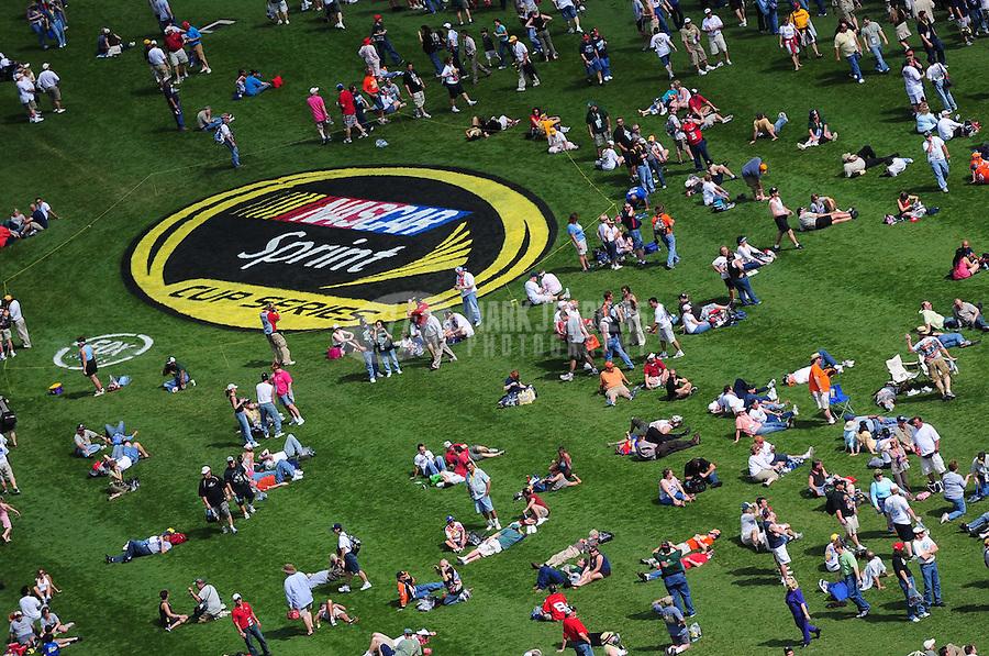 Feb 17, 2008; Daytona Beach, FL, USA; NASCAR Sprint Cup Series fans congregate in the infield grass prior to the Daytona 500 at Daytona International Speedway. Mandatory Credit: Mark J. Rebilas-US PRESSWIRE