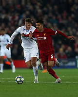 5th November 2019; Anfield, Liverpool, Merseyside, England; UEFA Champions League Football, Liverpool versus Genk; Roberto Firmino of Liverpool takes on Sander Berge of KRC Genk <br />