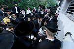 Israel, Bnei Brak. Passover at the Premishlan congregation, the Rabbi conducts ?Mayim Shelanu? (Our Water) ceremony, getting water from a local well for the Matzot baking the following day, 2005<br />
