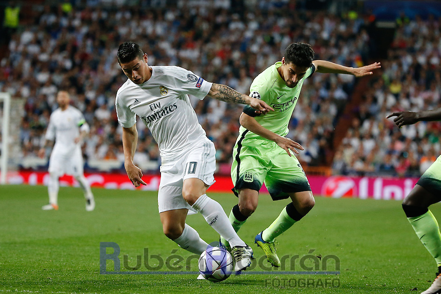 Real Madrid's Colombian midfielder James Rodriguez and Manchester City´s midfielder  Jesus Navas  during the UEFA Champions League match between Real Madrid and Manchester City at the Santiago Bernabeu Stadium in Madrid, Wednesday, May 4, 2016.