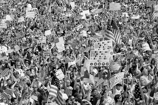 "Richmond, Virginia.USA.March 23, 2003..Nearly 20,000 people who support the US troops fighting in Iraq hold a ""Rally For America"". They pray at the beginning and the end of the rally, pledge the flag and sing a number of patriotic songs."