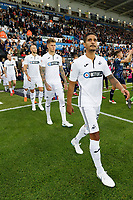 Kyle Naughton of Swansea City (R) and team mates exit the tunnel during the Sky Bet Championship match between Swansea City and Leeds United at the Liberty Stadium, Swansea, Wales, UK. Tuesday 21 August 2018