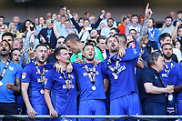 Joe Ralls, Craig Bryson and Sean Morrison of Cardiff City celebrate after being automatically promoted to the Premier League after the final whistle of the Sky Bet Championship match between Cardiff City and Reading at The Cardiff City Stadium, Wales, UK. Sunday 06 May 2018