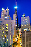 "Close up eastbound view at dusk of the Sofitel Hotel and Hancock Tower in the background. The architecture of Chicago has influenced and reflected the history of American architecture. The city of Chicago, Illinois features prominent buildings in a variety of styles by many important architects. Since most buildings within the downtown area were destroyed by the Great Chicago Fire in 1871, Chicago buildings are noted for their originality rather than their antiquity..Beginning in the early 1880s, architectural pioneers of the Chicago School explored steel-frame construction and, in the 1890s, the use of large areas of plate glass. These were among the first modern skyscrapers and amongst their most famous architects were William LeBaron, John Wellborn Root Sr., Daniel Burnham and Charles Atwood. Louis Sullivan was perhaps the city's most philosophical architect. Realizing that the skyscraper represented a new form of architecture, he discarded historical precedent and designed buildings that emphasized their vertical nature. This new form of architecture, by Jenney, Burnham, Sullivan, and others, became known as the ""Commercial Style,"" but it was called the ""Chicago School"" by later historians..Since 1963, a ""Second Chicago School"" emerged, largely due to the ideas of structural engineer Fazlur Khan. Some of Chicago's skyscrapers such as the John Hancock Center, Willis Tower (formerly known as the Sears Tower) and The Trump International Hotel and Tower are amongst the tallest buildings in the world."