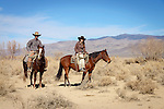 Jackie and Nick Dowers riding horses at the ranch in Dyer, Nevada