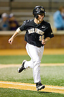 Andrew Williams (16) of the Wake Forest Demon Deacons hustles down the first base line against the North Carolina Tar Heels at Wake Forest Baseball Park on March 9, 2013 in Winston-Salem, North Carolina.  The Tar Heels defeated the Demon Deacons 20-6.  (Brian Westerholt/Four Seam Images)
