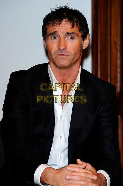 """MARTI PELLOW.Photocall for the launch for the UK tour of """"Jekyll and Hyde"""" at the Royal Institute of Great Britain, London, England..January 31st, 2011.half length black suit jacket white shirt .CAP/CJ.©Chris Joseph/Capital Pictures."""