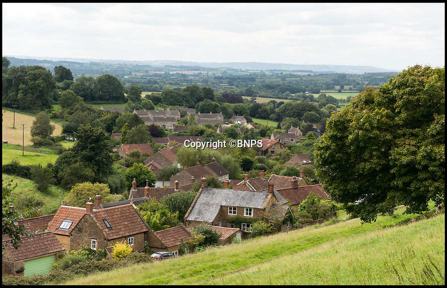 BNPS.co.uk (01202 558833)<br /> Pic: TomWren/BNPS<br /> <br /> View across the little changed Somerset village of Chiselborough whose residents have pieced together their history in photographs.<br /> <br /> A rural village's community has painstakingly put together its social history over the last 40 years, which is now going on display.<br /> <br /> Tony and June Perry first started collecting images of Chiselborough, in south Somerset, 40 years ago for the project which celebrates the village's people, traditions and buildings.<br /> <br /> Dozens of villagers have helped the couple compile 600 photos which are finally going to be shown in a new exhibition.<br /> <br /> The images, which date back to the 1860s, highlight many notable events in Chiselborough's history including the fire of 1890 which saw the pub burn down.<br /> <br /> Other photos show the silver jubilee party of 1935, a school fancy dress day in 1954 and the renovation of the village's 12th century church in 1971.<br /> <br /> Situated on the River Parrett, Chiselborough is five miles west of Yeovil and has a population of just 275 people.