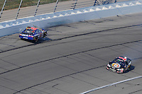 Sept. 27, 2008; Kansas City, KS, USA; NASCAR Nationwide Series driver Kyle Busch (32) crashes after contact with Mike Bliss (1) during the Kansas Lottery 300 at Kansas Speedway. Mandatory Credit: Mark J. Rebilas-