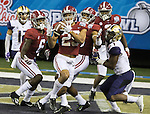 Alabama defensive back Minkah Fitzpatrick (29) intercepts a pass in the end zone intended for Washington wide receiver John Ross, right, in the closing seconds of the second half of the 2016 Peach Bowl at the Georgia Dome in Atlanta, Georgia on December 31, 2016. Alabama defeated Washington 24-7.  Photo by Mark Wallheiser/UPI