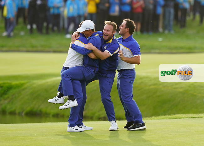 Thorbjorn Olesen (Team Europe)Tyrrell Hatton (Team Europe) Francesco Molinari (Team Europe) jumps on Alex Noran (Team Europe) celebrating his win on the 18th during the singles matches at the Ryder Cup, Le Golf National, Ile-de-France, France. 30/09/2018.<br /> Picture Fran Caffrey / Golffile.ie<br /> <br /> All photo usage must carry mandatory copyright credit (© Golffile | Fran Caffrey)
