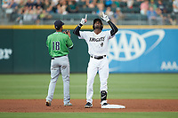 Luis Robert (9) of the Charlotte Knights points to the heavens after hitting a double against the Gwinnett Braves at BB&T BallPark on July 12, 2019 in Charlotte, North Carolina. The Stripers defeated the Knights 9-3. (Brian Westerholt/Four Seam Images)