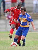 Ricki Mackin of Romford (R) and Clydie Roberts of Aveley - Romford vs Aveley - Pre-Season Friendly Match at Mill Field, Aveley FC - 31/07/10 - MANDATORY CREDIT: Gavin Ellis/TGSPHOTO - Self billing applies where appropriate - Tel: 0845 094 6026