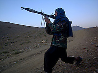 A foot soldier of teenage years from the Wardak Mobile Patrol Unit armed with an RPG [rocket propelled grenade] out on patrol in the mountains of wardak