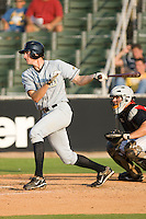 Justin Reynolds #33 of the Bowling Green Hot Rods follows through on his swing versus the Kannapolis Intimidators at Fieldcrest Cannon Stadium August 23, 2009 in Kannapolis, North Carolina. (Photo by Brian Westerholt / Four Seam Images)