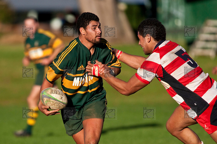 Maama Vaipulu looks to offload the ball as he is tackled by Tautaiafua Mata'afa. Counties Manukau Premier Club Rugby game between Pukekohe & Karaka played at Colin Lawrie Fields Pukekohe on Saturday May22nd 2010..Pukekohe won the game 32 -28 after trailling 3 - 22 at halftime.