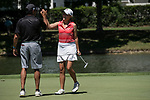 HOUSTON, TX - MAY 12: Rhodes College on course coach, Sam Kern, left, high fives player Emily Salamy on the 18th green during the Division III Women's Golf Championship held at Bay Oaks Country Club on May 12, 2017 in Houston, Texas. (Photo by Rudy Gonzalez/NCAA Photos/NCAA Photos via Getty Images)