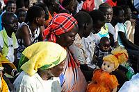 SOUTH SUDAN  Bahr al Ghazal region , Lakes State, town Rumbek, sunday mass at catholic church, women with white barbie doll