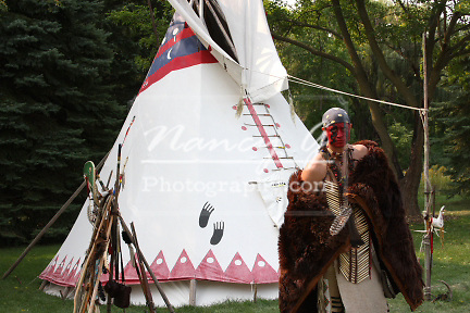 Native American Indian man wearing a buffalo skin robe