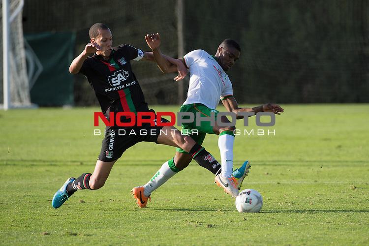 Trainingsgel&auml;nde, Jerez, ESP, 1.FBL, FSP  Werder Bremen (GER)  vs NEC Nijmegen (NED),  12.01.2014, <br /> <br /> Ryan Koolwijk (NEC #8)<br /> C&eacute;dric Makiadi (Bremen #6)<br /> <br /> Foto &copy; nordphoto/ Kokenge