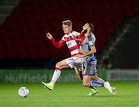 Lincoln City's Jorge Grant is fouled by  Doncaster Rovers' Kieran Sadlier<br /> <br /> Photographer Andrew Vaughan/CameraSport<br /> <br /> EFL Leasing.com Trophy - Northern Section - Group H - Doncaster Rovers v Lincoln City - Tuesday 3rd September 2019 - Keepmoat Stadium - Doncaster<br />  <br /> World Copyright © 2018 CameraSport. All rights reserved. 43 Linden Ave. Countesthorpe. Leicester. England. LE8 5PG - Tel: +44 (0) 116 277 4147 - admin@camerasport.com - www.camerasport.com
