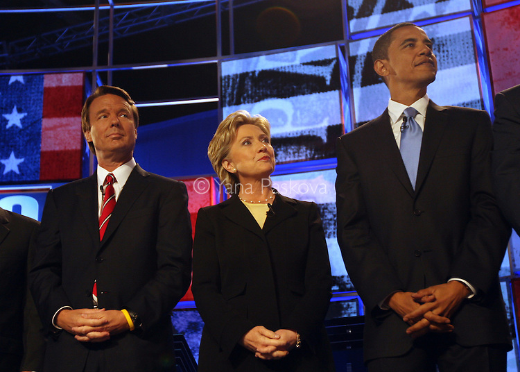 Democratic presidential candidates (L-R) former Sen. John Edwards (D-NC), Sen. Hillary Clinton (D-NY), and Sen. Barack Obama (D-IL) wave to the audience from the stage before their debate at St. Anselm College on June 3, 2007, in Manchester, New Hampshire. The debate's sponsors include CNN, Hearst Argyle's WMUR-TV and the New Hampshire Union Leader. The Republican candidates' debate is scheduled on June 5, 2007.