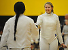 Lizzie Colonna of Commack, right, and Delmy Santos of Brentwood exchange pleasantries before their epee bout in a girls fencing match at Commack High School on Friday, Dec. 2, 2016.