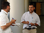 NY Post reporter, Damon ? with Newsday Reporter, Alfonso Castillo, talking in hallway waiting for the start of for the opening of trial of Arelis Mora at Suffolk Criminal Court Building in Riverhead on Monday August 1, 2005. Mora is accused of being responsible for the death of Jennifer Victoria Centano, a child that was under her care. (Newsday Photo / Jim Peppler).