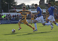 Scott Moore gets away from Sebestian Faure (centre) and Emilson Cribari in the Forres Mechanics v Rangers William Hill Scottish Cup 2nd Round match, at Mosset Park, Forres on 29.9.12.