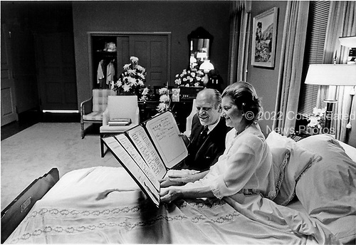 """United States President Gerald R. Ford and first lady Betty Ford look over a petition of """"support and best wishes"""" signed by all 100 members of the United States Senate in Mrs. Ford's hospital room at the Bethesda National Naval Medical Center in Bethesda, Maryland on October 3, 1974.  Mrs. Ford is at Bethesda recovering from cancer surgery.<br /> Mandatory Credit: David Hume Kennerly / White House via CNP"""