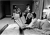 "United States President Gerald R. Ford and first lady Betty Ford look over a petition of ""support and best wishes"" signed by all 100 members of the United States Senate in Mrs. Ford's hospital room at the Bethesda National Naval Medical Center in Bethesda, Maryland on October 3, 1974.  Mrs. Ford is at Bethesda recovering from cancer surgery.<br /> Mandatory Credit: David Hume Kennerly / White House via CNP"