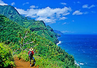 Hiker on the Kalalau Trail sees Na Pali coastline