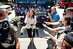 GOP Presidential candidate Rep. Michele Bachmann speaks with reporters during at a campaign stop at Palmer's Deli in Des Moines, Iowa, July 20, 2011.