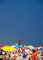 A lifeguard on a stand overlooking crowds at the beach. Cape Cod National Sea Shore, Massachusetts.<br />
