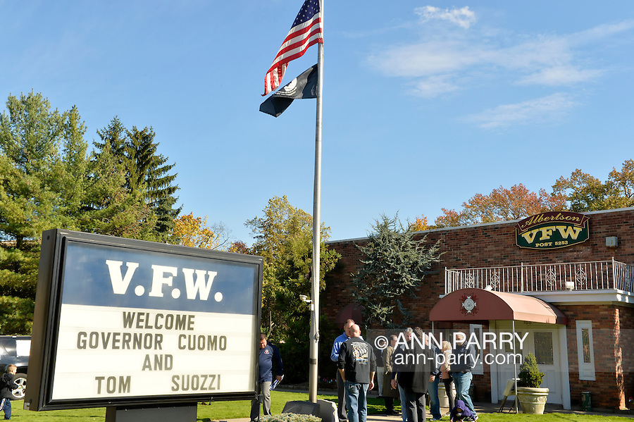 Albertson, New York, U.S. 26th October 2013. New York Governor Cuomo endorses Suozzi for Nassau County Executive at the Albertson Veterans of Foreign Wars VFW Post. Democrat Suozzi, the former Nassau County Executive, and Republican incumbent Mangano face each other in a rematch in the upcoming November 5th election.