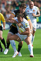 Luke Arscott of Exeter Chiefs is tackled by Ben Foden of Northampton Saints during the Aviva Premiership match between Northampton Saints and Exeter Chiefs at Franklin's Gardens on Sunday 9th September 2012 (Photo by Rob Munro)