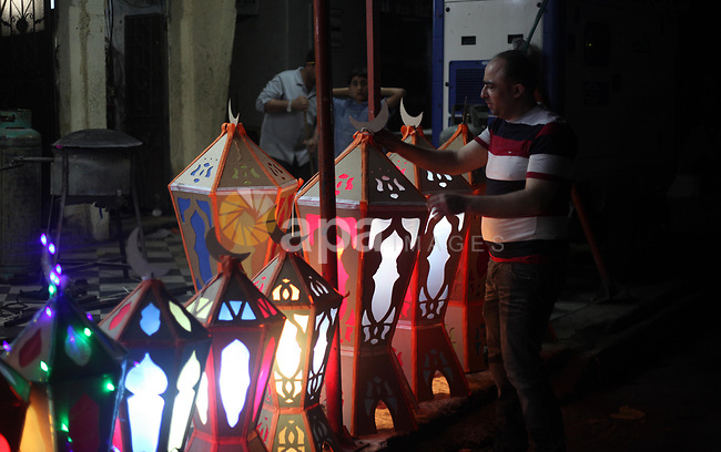 "A Palestinian man manufactures a traditional Ramadan lantern known as ""Fanous"" in Arabic, at his workshop ready for the month of holy Ramadan in Gaza City on May 13, 2018. Photo by Mahmoud Ajour"
