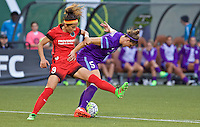 Portland, OR - Sunday, April 17, 2016: Portland Thorns FC forward Nadia Nadim (9) battles Orlando Pride defender Laura Alleway (5) for the ball. The Portland Thorns FC defeated the Orlando Pride 2-1 during a National Women's Soccer League (NWSL) match at Providence Park.