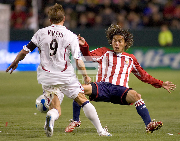 Chivas USA MID Francisco Mendoza (6) defends against attacing RSL MID Jason Kreis (9) during a MLS game. Chivas USA beat Real Salt Lake 4-0 at the Home Depot Center in Carson, California, Saturday, April 21, 2007.