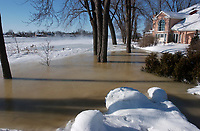 Ice pile up make a river,near Montreal, overflow.January 14 2004<br />