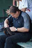Kannapolis Intimidators trainer Joe Geck repairs a broken webbing on a first baseman's mitt during the game against the Hickory Crawdads at Kannapolis Intimidators Stadium on May 2, 2018 in Kannapolis, North Carolina.  The Intimidators defeated the Crawdads 9-6.  (Brian Westerholt/Four Seam Images)