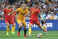 26 November 2017, Melbourne - MA JUN (32) of China PR kicks the ball during an international friendly match between the Australian Matildas and China PR at GMHBA Stadium in Geelong, Australia.. Australia won 5-1. Photo Sydney Low